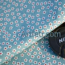 Ткань мелкий белый цветочек на синем