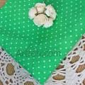 Зеленая ткань в белый мелкий горох.
