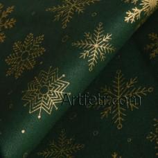 Ткань темно-зеленого цвета с золотой снежинкой
