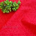 Ткань коралловые снежинки на красном фоне с блестками