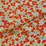 Желтая ткань красные ягоды клубники