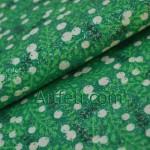 Зеленая ткань с белыми ягодами и глиттером блестками