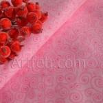 Ткань розовая с завитками